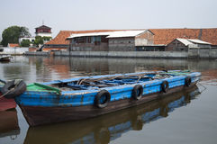 Rusty old boat. In a river in Jakarta Stock Photo