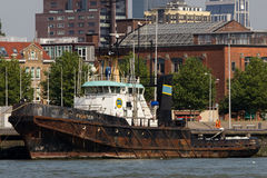 Rusty Old Boat. An old tug boad sits idle along the Maas river in Rotterdam Royalty Free Stock Photography
