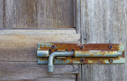 Rusty old bolts on the wooden door Royalty Free Stock Photography