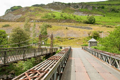 Rusty old bridge in the Elan valley of Wales. A view of a rusty old bridge in the Summertime of the Elan valley in Wales Royalty Free Stock Image