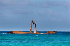 Rusty old broken ship tanker in blue sea Stock Photo