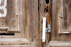 Rusty old cabin door handle in dusky light closeup Royalty Free Stock Photos