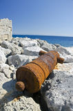 Rusty old cannon in Rhodes island near fort, Greece Stock Photos