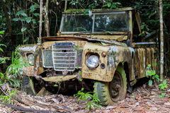 Rusty old car in jungle Stock Photos
