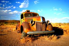 Rusty old car in Namibia. Rusty old car in the Namibia desert Stock Photos