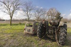 Rusty old car and tractor Stock Photo