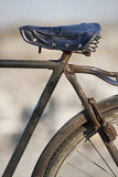Rusty old Chinese bicycle. Against a light blurred background Royalty Free Stock Photos