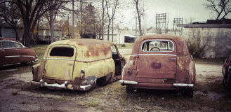 Rusty old classic cars Stock Images