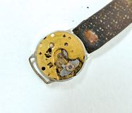 Rusty old clock mechanism on white background,. Image of a Royalty Free Stock Image