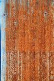 Rusty old corrugated iron fence Royalty Free Stock Image