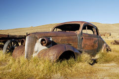 Rusty Old Coupe 1. A vintage car left to rust in a ghost town in California Royalty Free Stock Images