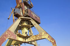 Rusty old crane Stock Images