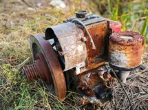 Old diesel engine used in agriculture. Rusty Old diesel engine used in agriculture rests on a pile of hay Royalty Free Stock Photos