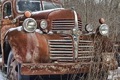 Rusty old dodge truck lies abandoned. A Rusty old dodge truck lies abandoned royalty free stock photos