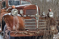 A rusty old dodge truck lies abandoned Stock Images