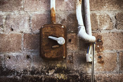 Rusty Old Electric switch bare cables brickwall Royalty Free Stock Images