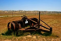 Rusty old Farm Equipment in field Royalty Free Stock Photos