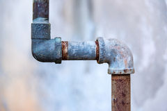 Rusty old faucets and piping system in backyard. Royalty Free Stock Image