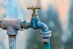 Rusty old faucets and piping system in Cuban backyard Stock Photography