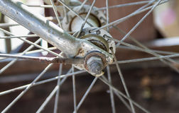 Rusty on old front bicycle wheel hub, close up Stock Images
