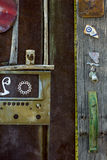 Rusty old Gate With Eclectic Americana arrangement of crafty found art. Rusty Gate entry with found art Americana arrangement of objects Royalty Free Stock Images
