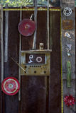 Rusty old Gate With Eclectic Americana arrangement of crafty found art. Rusty Gate entry with found art Americana arrangement of objects Royalty Free Stock Photography