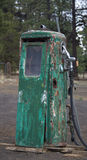 Rusty old green gas pump with personality. Old time gas pump brings back memories of a past era Stock Photos