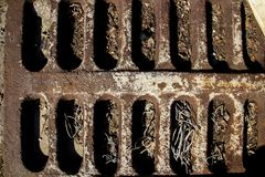 Rusty old grill. Brown surface with longitudinal dents royalty free stock photo