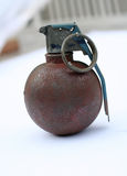 Rusty old hand grenade. Close up of rusty old hand grenade with pin attached Royalty Free Stock Images