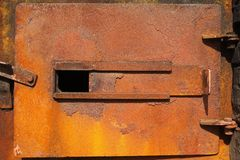 Rusty old incinerator or kiln door Stock Image