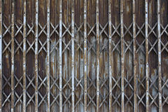 Rusty old iron door of abandoned house and deteriorate. Royalty Free Stock Photo