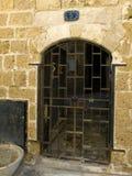 Rusty old iron lattice door Stock Photo