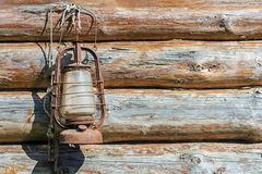 Rusty old kerosene lamp on the background of the wooden frame Stock Photos