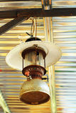 Rusty old kerosene lamp hanging. Stock Photography