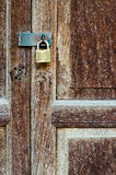 Rusty old key lock on old hardwood door Stock Photography