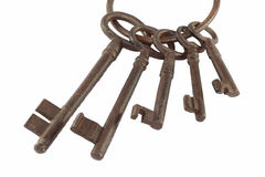 Rusty Old Keys. Five different size rusty keys, isolated royalty free stock photo