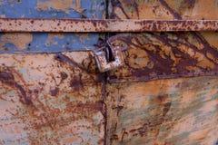 Rusty, old lock on the gates stock photo