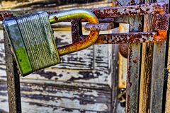 Rusty, old, locked padlock on a latch horizontally Royalty Free Stock Image