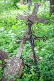 Rusty old metal crucifix Stock Photo