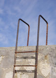 Rusty old metal ladder. In the sky Royalty Free Stock Photography