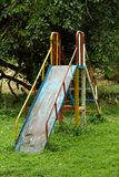 Rusty Old Metal Playground Slide royalty free stock photo