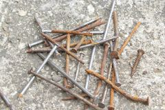 Rusty old nails from our home stock photography