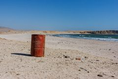 Old oil barrell on the beach. Paracas, Peru royalty free stock photo