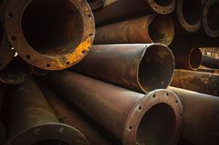 Rusty old pipes stacked up Royalty Free Stock Images