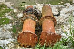 Rusty Old Pipework. Rusty old redundant metal pipework discarded and left on river bank royalty free stock images