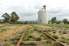 Rusty old railway tracks and wheat silo Stock Images