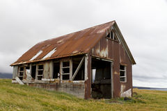 Rusty old shed. Run down old shed clad in rusty corrugated iron, situated on the coast Stock Photos