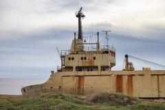 Rusty old ship near shore Stock Photo