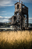 Rusty old shipping terminal with a blue sky. And grass Royalty Free Stock Photography