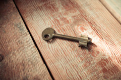 Rusty Old Skeleton Key on Dark Rustic Barnwood Royalty Free Stock Photo